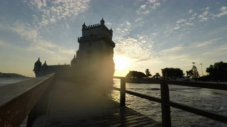 lizbona : LISBON, PORTUGAL - CIRCA OCTOBER 2018: scenic sunset at the tower of Belem Wideo