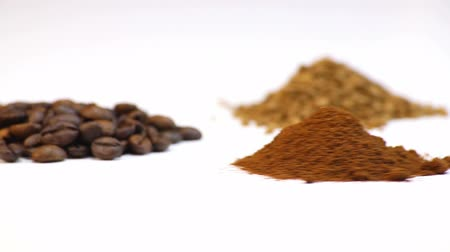 oldódó : Coffee beans, ground coffee, soluble coffee on white background Stock mozgókép
