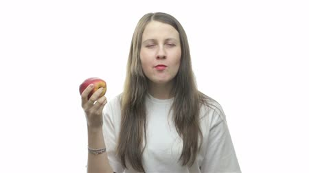 eat background : Brunette woman eating apple, first video