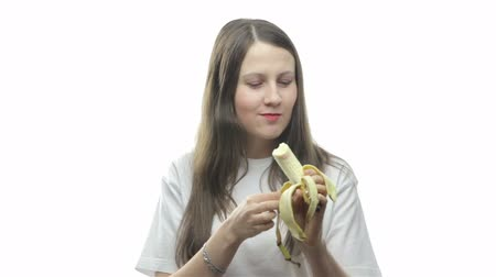 muz : Brunette woman eating banana, second video Stok Video
