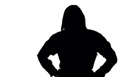 crossed : Silhouette of unhappy grumpy woman Stock Footage