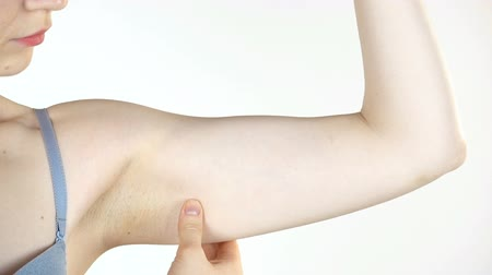 liposukcja : Young woman and flabby hand