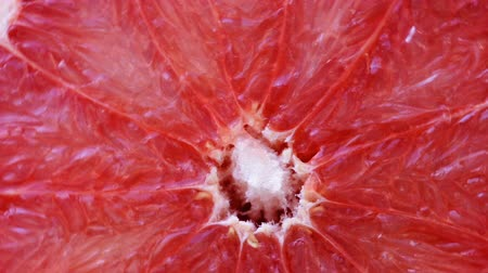 grejpfrut : Rotating slice of grapefruit Wideo