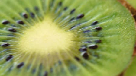 цитрусовые : Rotating background of fresh kiwifruit