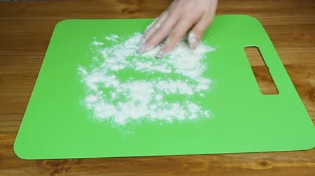 baking ingredient : Woman pouring flour Stock Footage