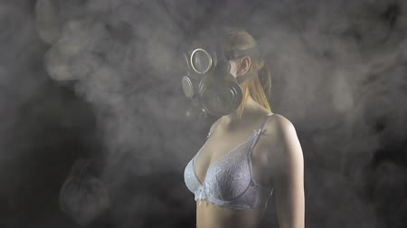 respirator : Young girl in gas mask wearing white underwear