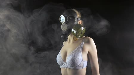 mcu : Girl in gas mask wearing white lingerie Stock Footage
