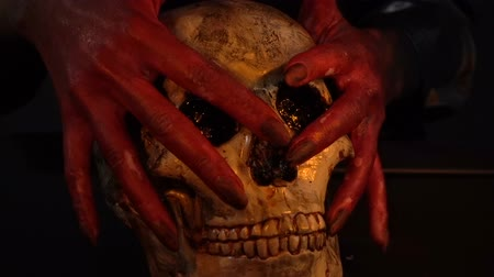 pohanský : Woman with blood hands holding skull