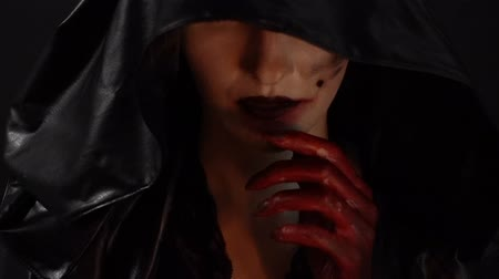 pohanský : Woman with blood hands touching mouth