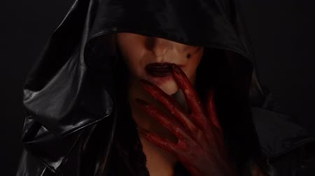 pohanský : Witch with blood hands touching mouth