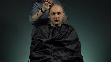 barber hair cut : Hairstylist and bald brunette man