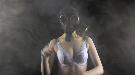 mcu : Young girl in gas mask in white lingerie