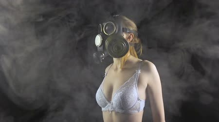underwear : Young girl in gas mask wearing white lingerie Stock Footage