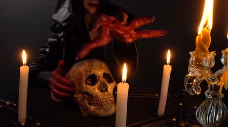 pohanský : Woman with skull and candles