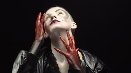 pohanský : Girl with blood hands touching face