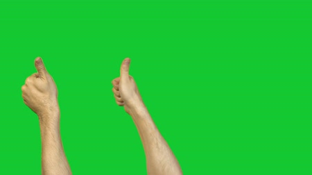okey : Male thumbs on green background Stock Footage