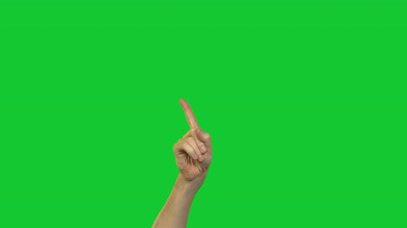taboo : Male stop gesture on green background