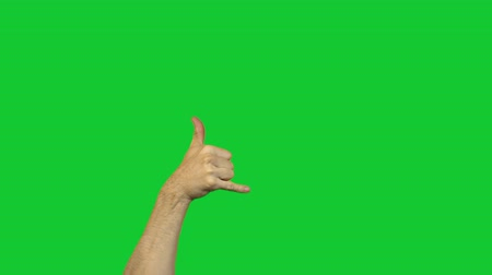 pinky : Male drinking alcohol gesture on green background