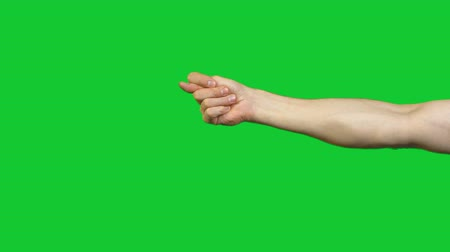 higo : Showing fico gesture on green background Archivo de Video