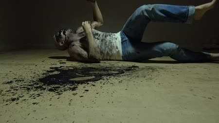 vomit : Laying man vomiting black goo Stock Footage