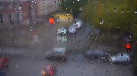 kondenzace : Rainy day and rolling drops of water, view from the window