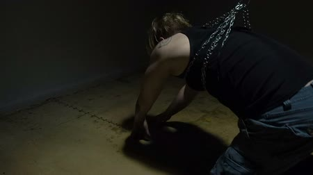 tutuklu : Blond man bound in chains Stok Video