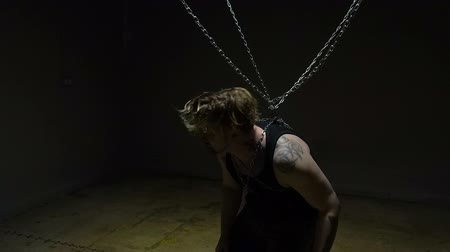 tutuklu : Crazy blond prisoner bound in chains Stok Video