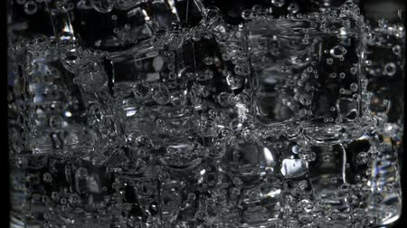 macro shooting : Macro shooting of soda water with bubbles in glass