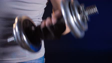biceps : Shooting of man with metal dumbbell
