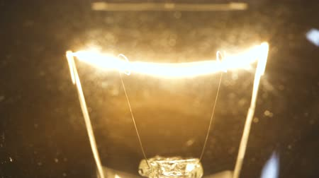 filamento : Video of incandescent lamp on black background