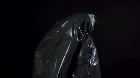 levendig : Video of human in black garbage bag Stockvideo