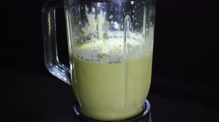 zeller : Shaking vegetables in a blender on a black background