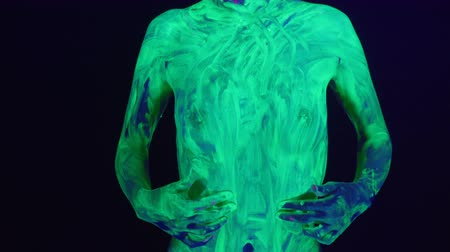 göğüs : Girl with naked breast in ultraviolet light