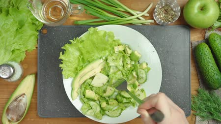 saŁata : Footage of cooking salad on black board with vegetables