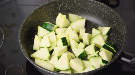 Cooking braised zucchini in the skillet Stock Footage