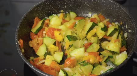 Cooking the braised zucchini in the skillet 動画素材