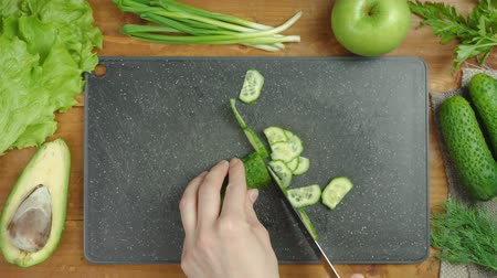 Cooking green salad on black board