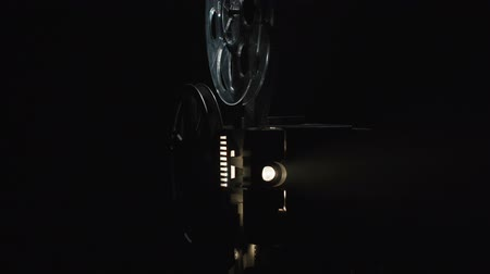 Shooting of old film projector on black background