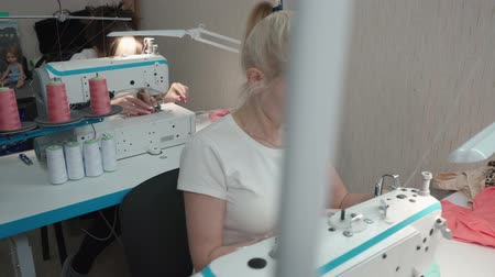 rád : Video of two tailor woman sewing clothes on electric machine