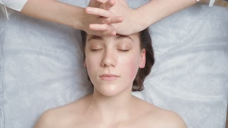 Young woman gets a facial massage course Stock Footage