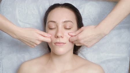 Woman gets a facial massage course in salon