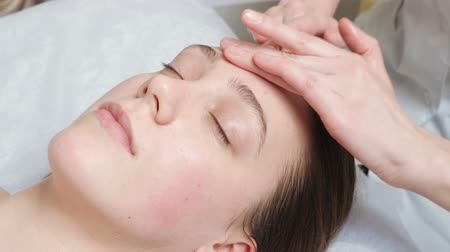Shooting of lying woman gets a spa course in clinic Stock Footage