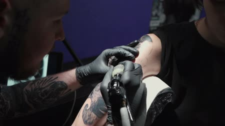 inked : Video of doing black tattoo of snake for woman