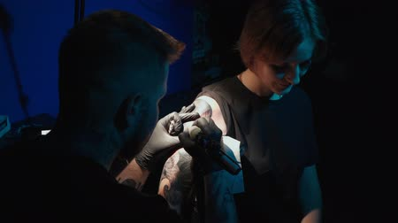 inked : Shooting of man doing tattoo of snake on woman in studio
