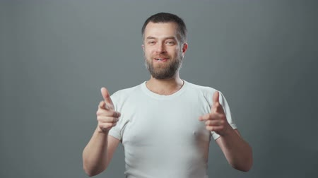 kciuk : Video of young man with beard showing yes gesture