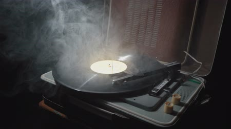 gramophone : Old gramophone with a rotating record and smoke