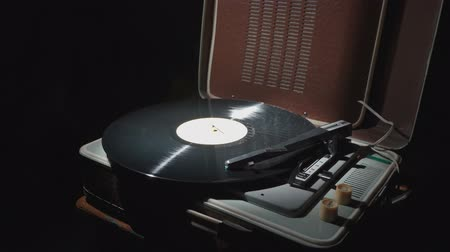 equalizador : Video of a retro gramophone with a rotating record and smoke