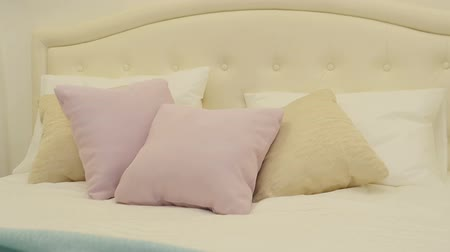 linen : Pillows on the bright bed