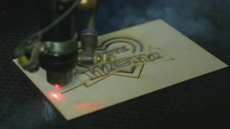 desenli : Laser cutting machine at work on wood
