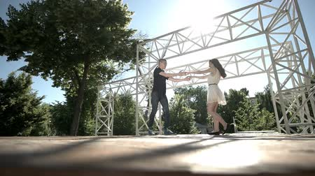 fool : Couple dance on a stage in the park Stock Footage